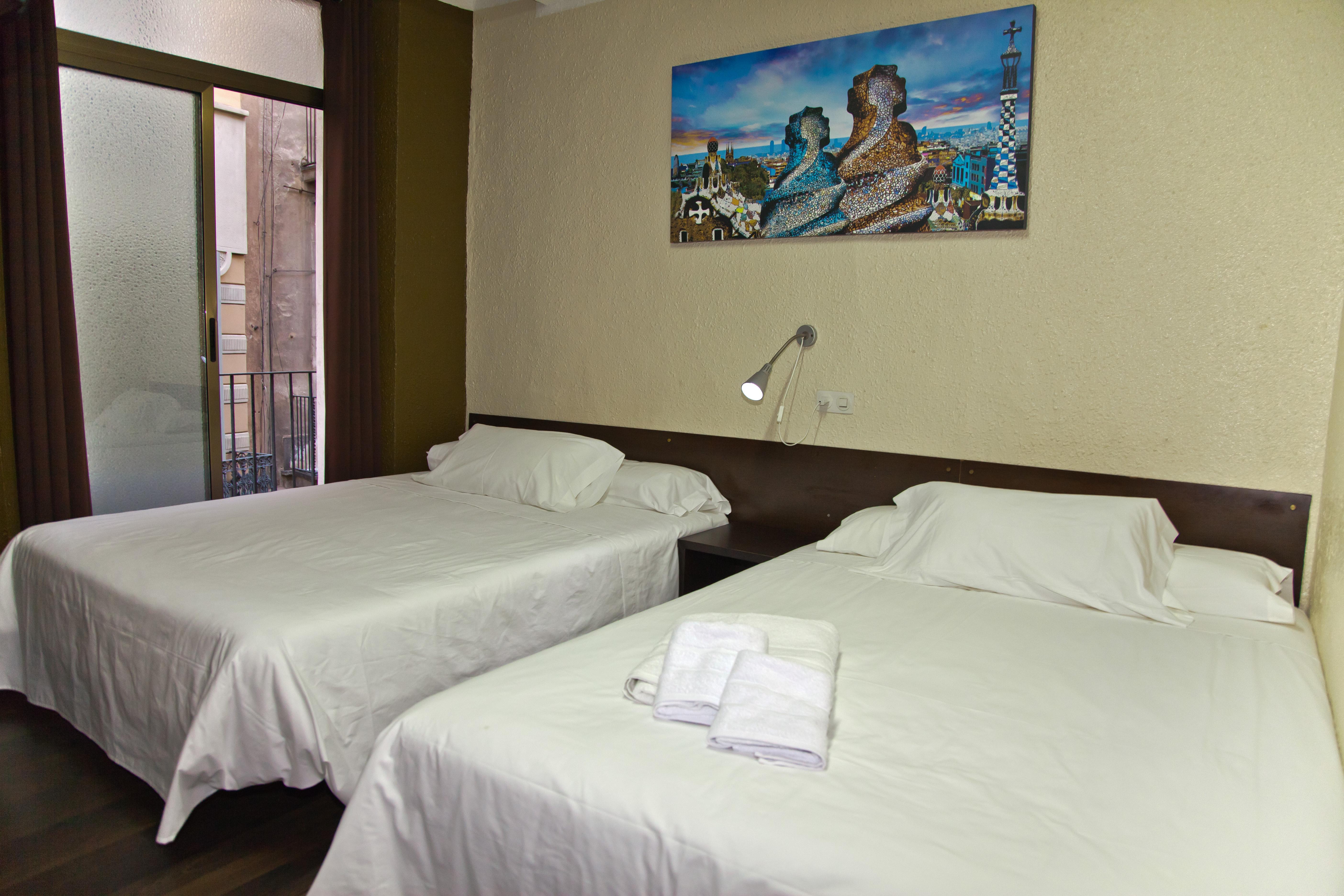 Foto hostal par s centro di barcellona sito web ufficiale for Hotel france barcelona